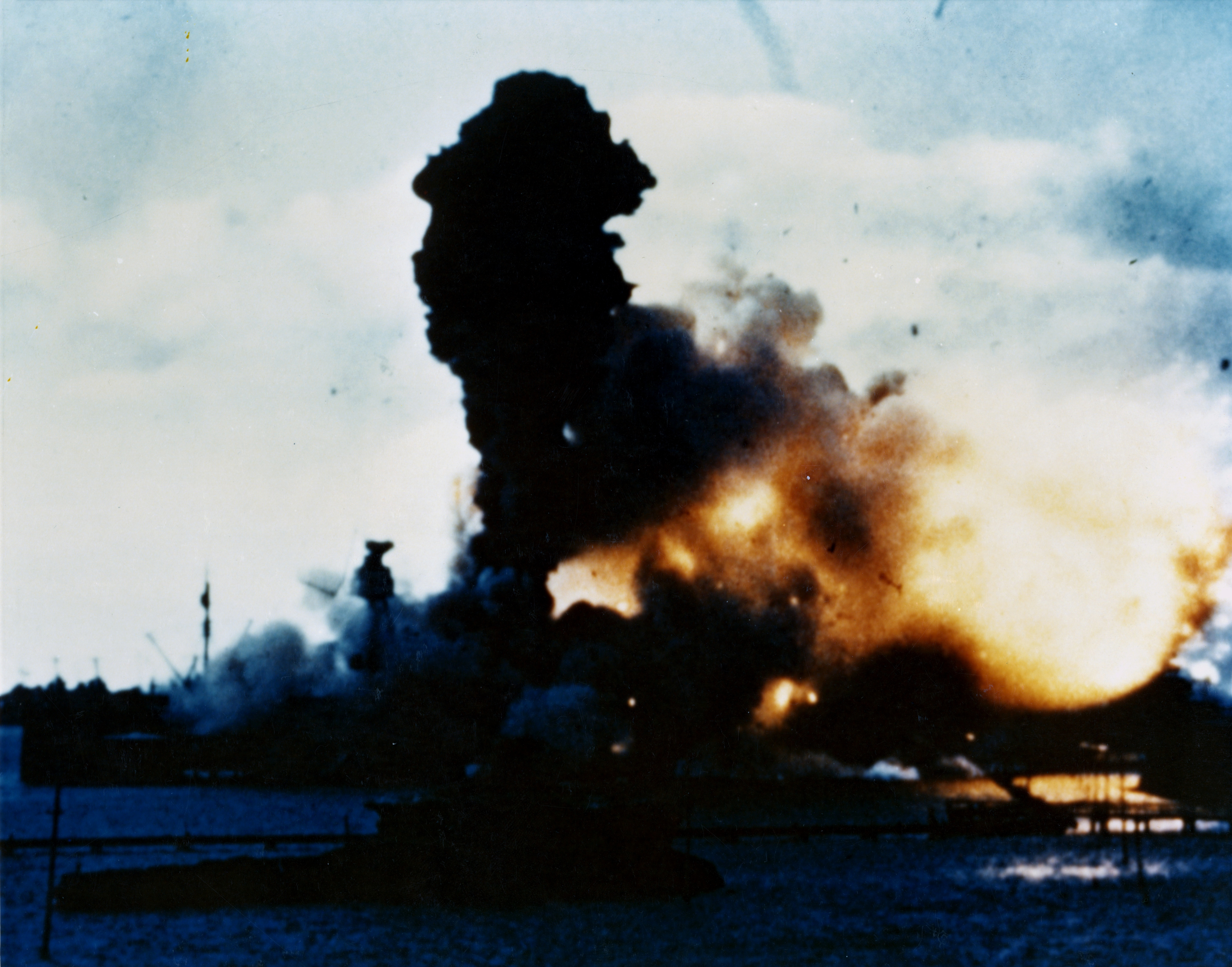The forward magazines of the U.S. Navy battleship USS Arizona (BB-39) explode shortly after 08:00 hrs during the Japanese attack on Pearl Harbor, Hawaii (USA), 7 December 1941.