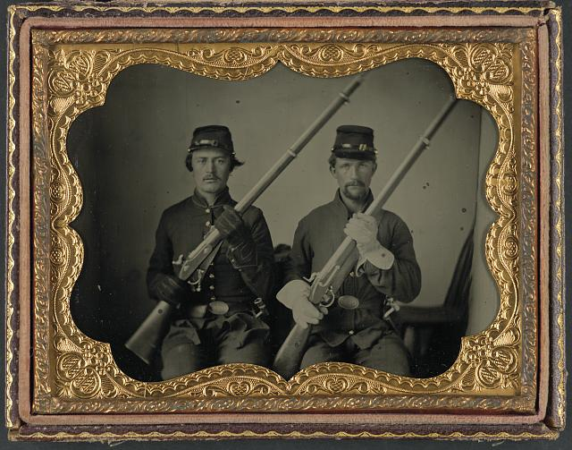 Two soldiers identified as Wesly Scott and L.P. Nash in Union uniforms and Ohio Volunteer Militia belt buckles with muskets. Library of Congress Prints and Photographs Division Washington, D.C. 20540 .
