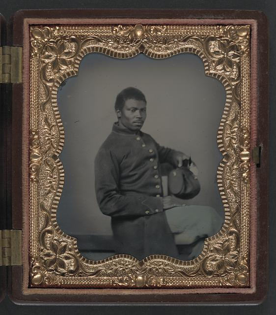 African American soldier in Union uniform. Between 1863 and 1865. LOC.