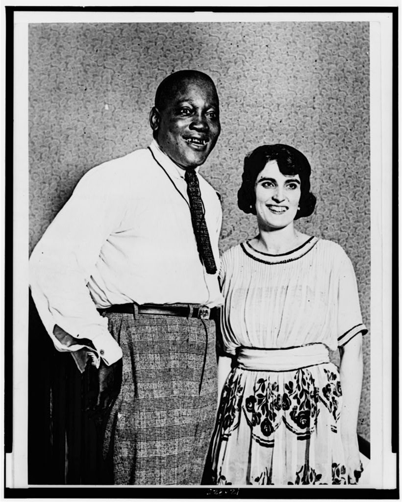 [Jack Johnson and wife, three-quarter length portrait, facing slightly right]. 1921.
