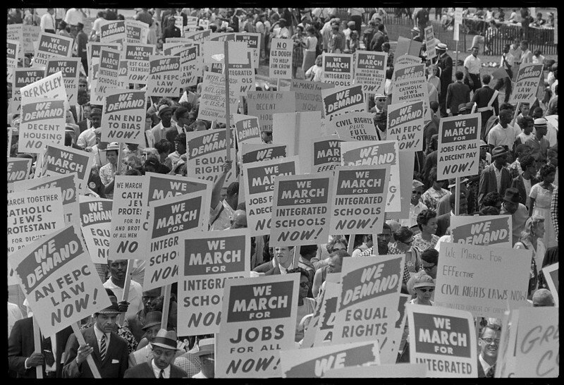 Protestors hold signs during the March on Washington, 1963.